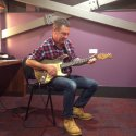Andy with Rory Gallagher's battered 1961 Fender Stratocaster Sunburst